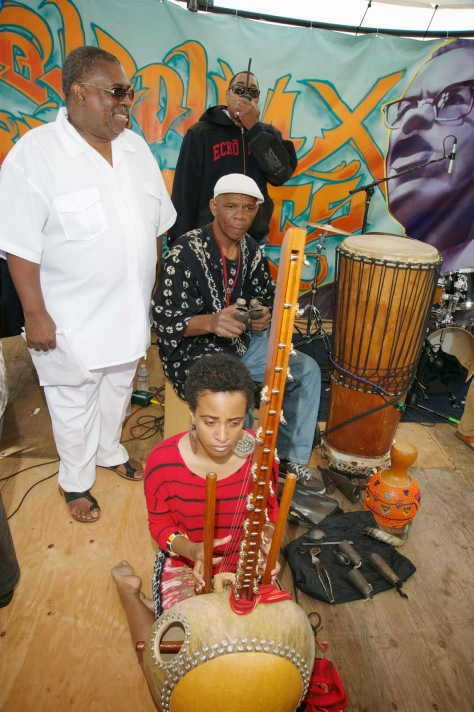 X and Tacuma King and girl with african instrument