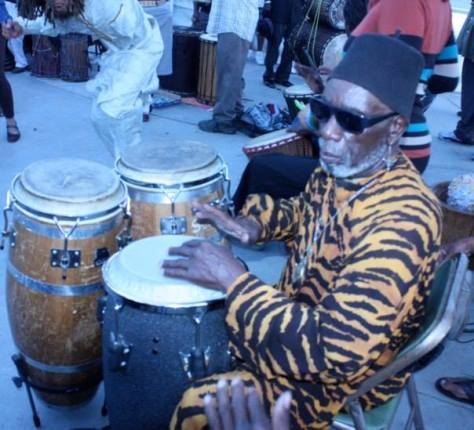 african drummer w tiger outfit