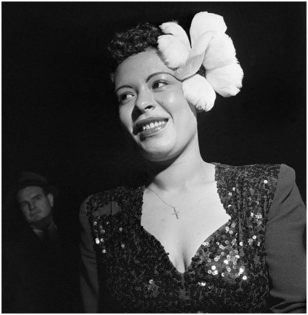 billie-holiday-wears-a-large-white-flower-in-her-hair-for-a-performance-in-new-york-city-1940s-photo-bradley-smith-corbis-images