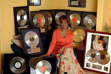 Steph Sitting amongst her Record Award Wall of Fame
