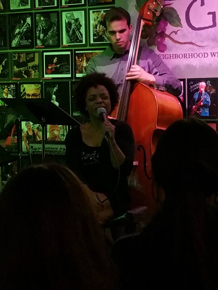 Sandra Booker seated with bassist Mike Gurrola
